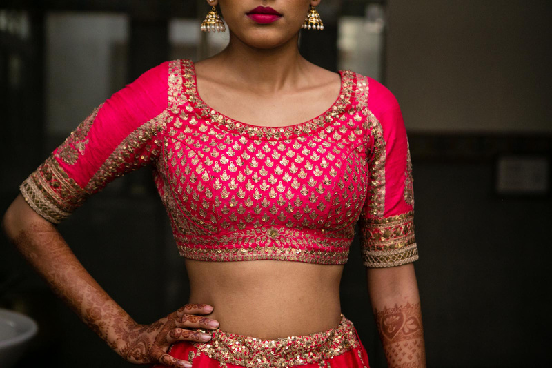Pink bridal lehenga blouse with sequin and zari work