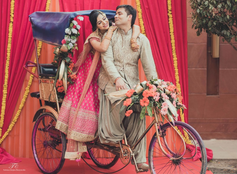rickshaw with bride and groom